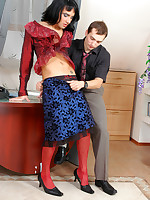 Hot sissy in a glamour outfit with red stockings getting nailed on the desk