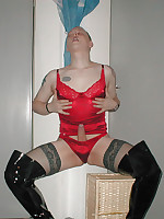 Crossdressing slut pissing and using a dildo