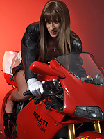 This sexy crossdresser looks fantastic on her Ducati