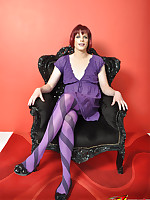 Sexy TGirl wearing a purple dress and posing on the throne.