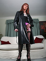 Tgirl Lucimay wearing long pvc coat with her whip
