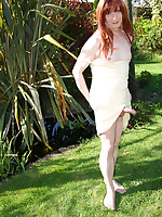 Lucimay outdoors in her garden and playing with her cock