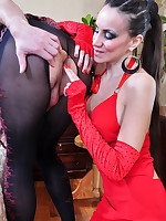 Cross-dressed hunk in crotchless tights strap-on fucked by a lady in red