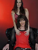 Jane gets on her knees and puts her head between a TGirls legs