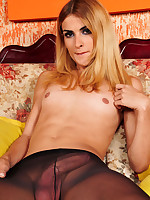 Horny shemale demonstrating her rock-hard schlong through black pantyhose