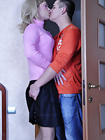 Funky sissy in bright female clothes and a wig seducing his gay boyfriend